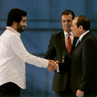 The founder of WiRE Microsystems, Mahmoud Saad, while receiving the award from Mr. President Abdel Fattah el-Sisi